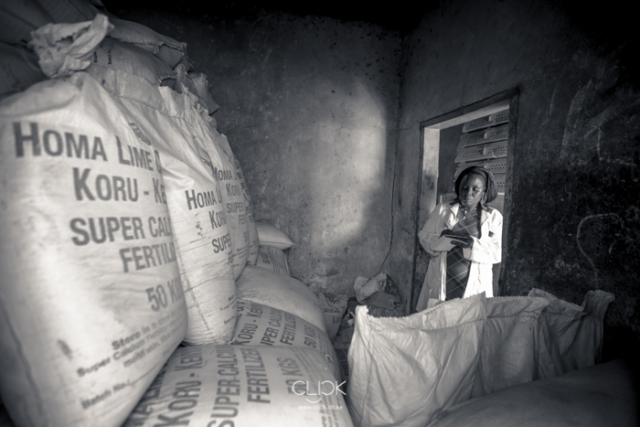 Ann Munala checks her fertiliser stocks in her store in Luanda Market, Kenya, on 21st July 2016. Being one of the leading stockists of lime based fertiliser in the region, Ann has helped educate farmers on the benefits of planting in nutrient-rich soils. This after she received training on the same from Kenya Agricultural and Livestock Research Organisation in partnership with Agra. Ann testifies that she has seen farmers grow their harvest exponentially through the lessons she's shared with them.