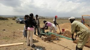 5. scraping off excess sand:dirt:cement