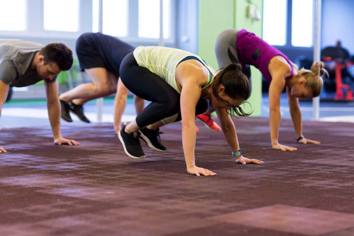 Fitness Sport And Healthy Lifestyle Concept Group Of People Exercising In Gym Group Of People Exercising In Gym