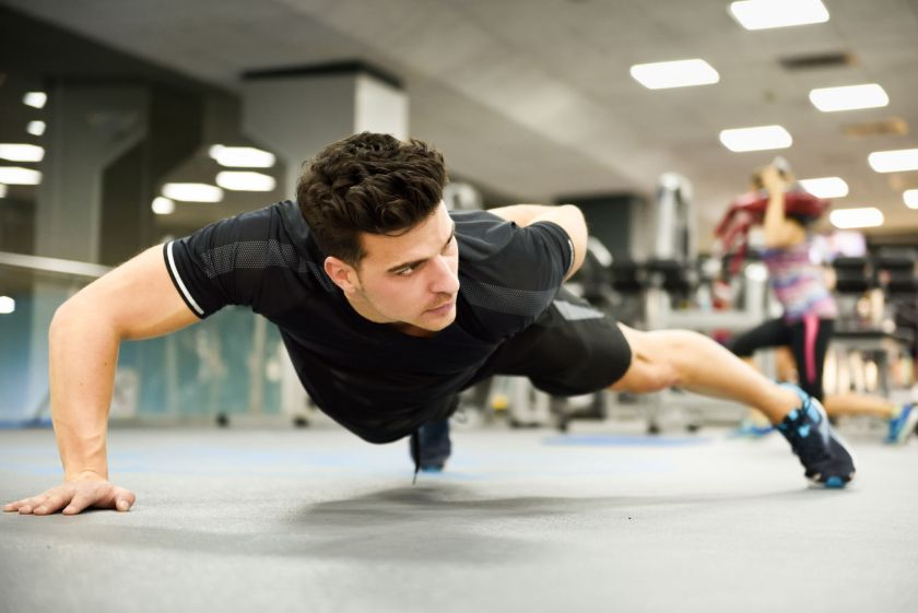 Attractive Man Doing Pushups In The Gym Guy Wearing Sportwears Clothes