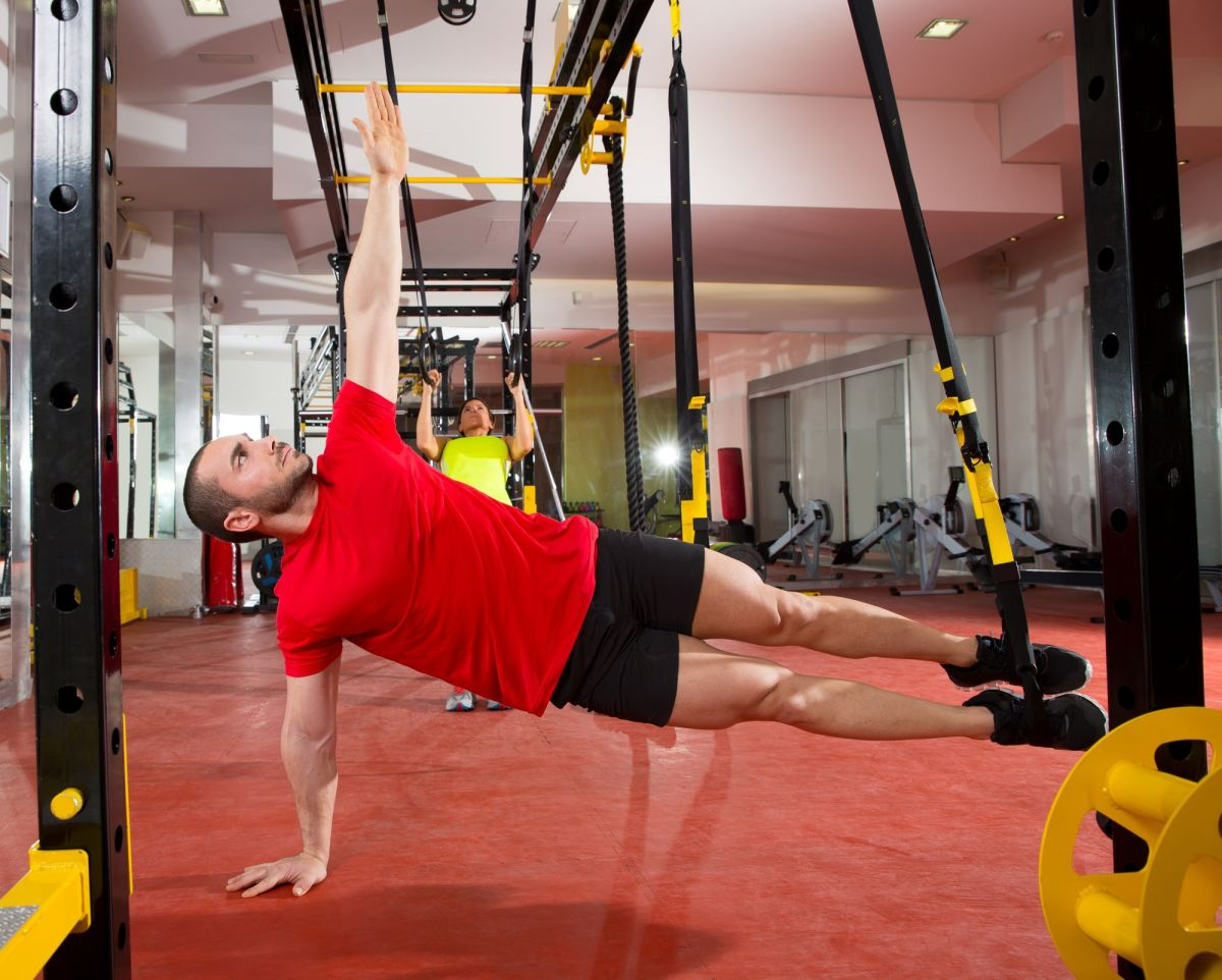 Crossfit Fitness Trx Training Exercises At Gym Woman And Man Side Push Up Workout