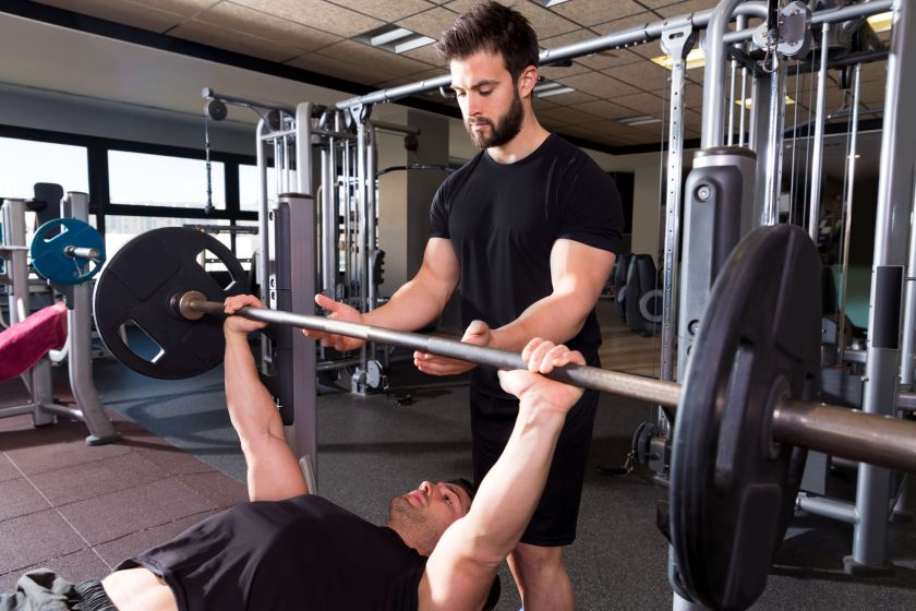 Personal Trainer In Fitness Gym