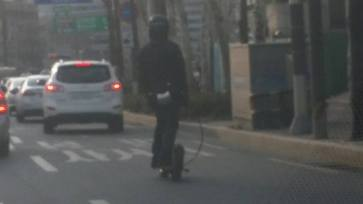 Motorized skateboard. Hard to see but he has the gas tank or battery and throttle hanging off his belt. Was going 40 MPH in traffic