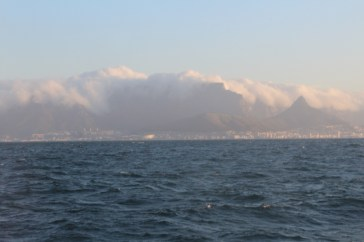 """Table Mountain with the """"table cloth"""" coming in at dusk"""