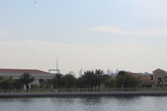 """Burj Kalifia from boat ride - you can see """"The Frame""""in the foreground. About the same height at the St.Louis Arch. The building with the triangle top is the same height as the Empire State building."""
