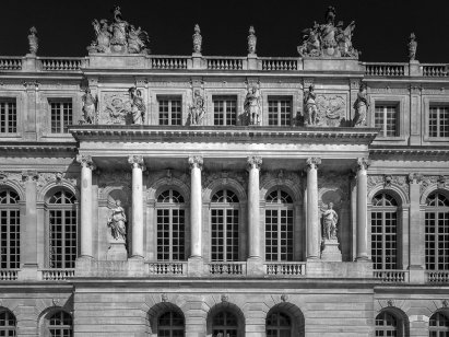 A black and white detail of the facade of Versailles, France.