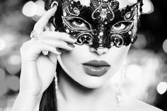 34792222 - sexy woman wearing carnival mask over holiday glowing background