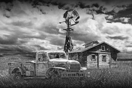 old-vintage-junk-dodge-pickup-in-black-and-white-with-decaying-barn-randall-nyhof