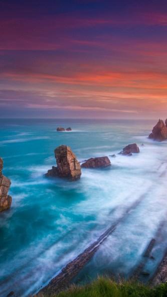 beach-1080x1920-aerial-view-sunset-playa-de-portio-spain-4k-5k-17628