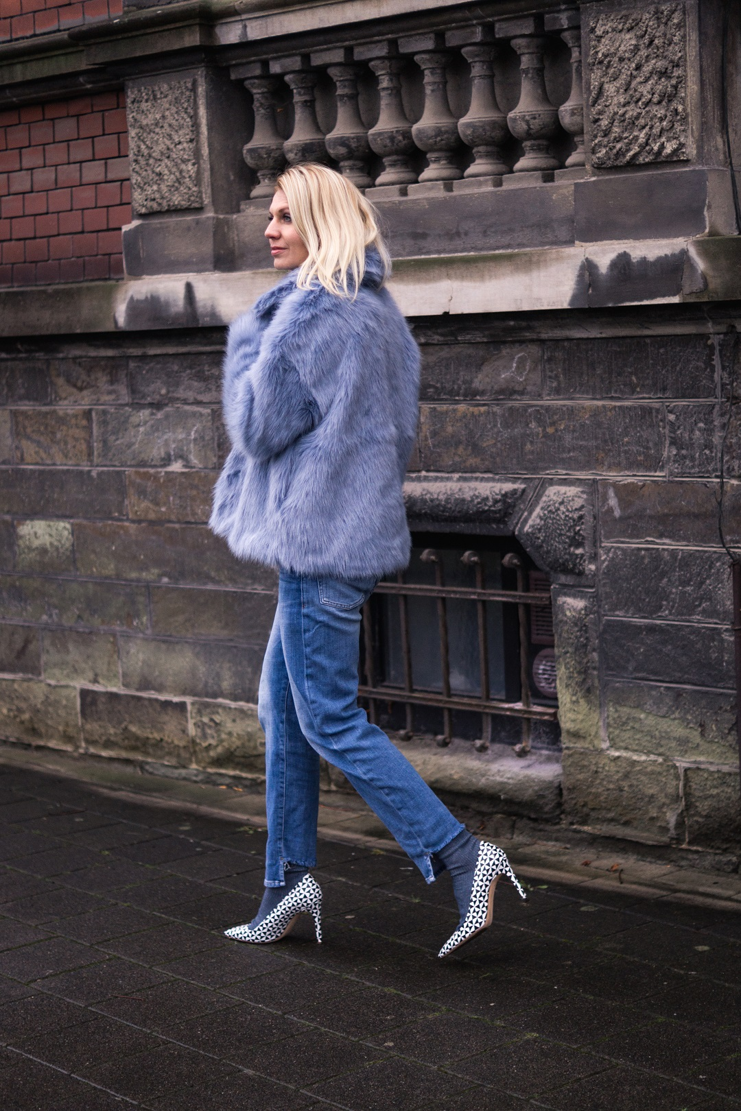 faux-fur jacket and pumps