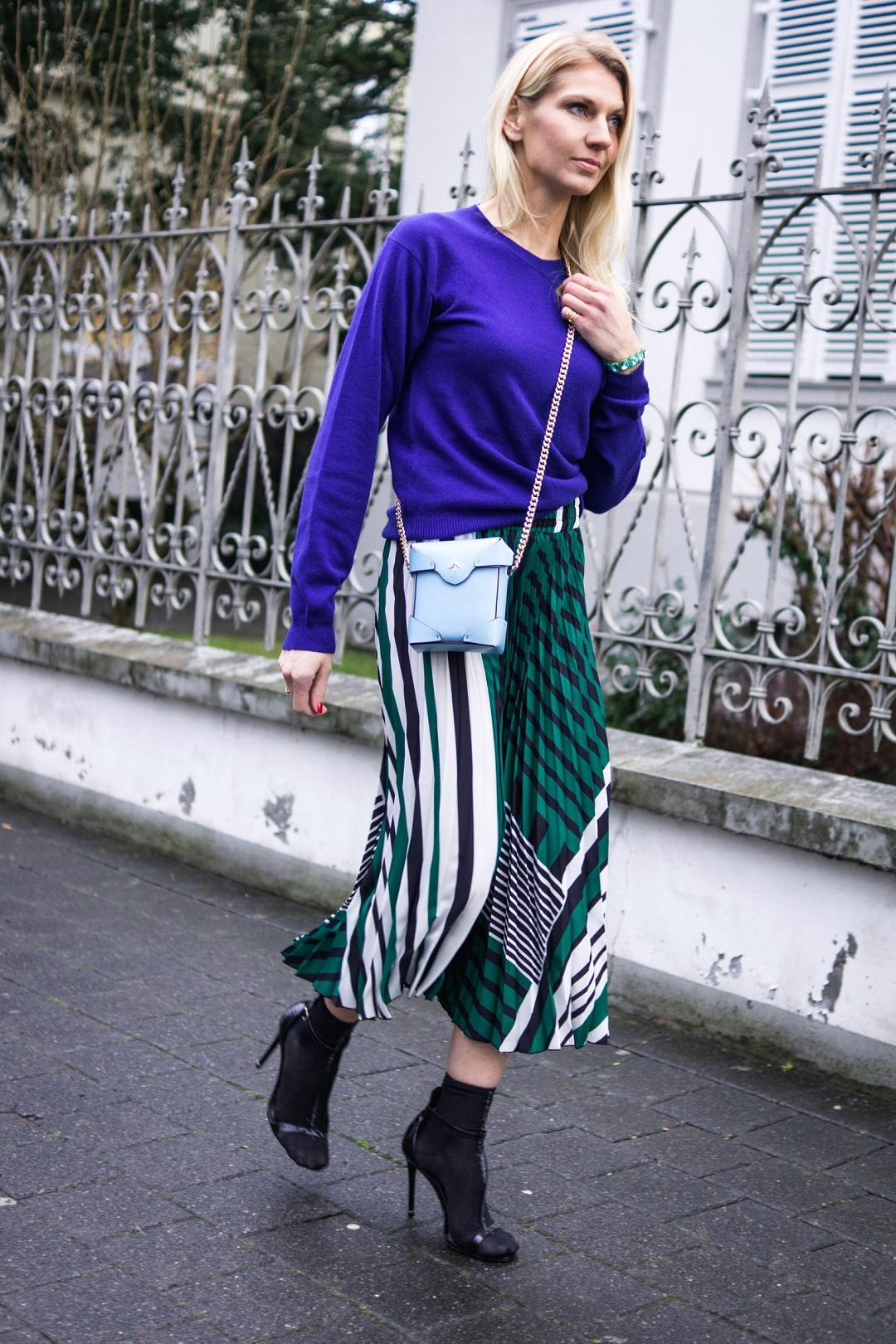 Cashmere sweater by Ferramosca and striped Mango skirt