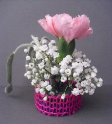 PHOTO: a tiny bouquet of mini carnation, baby's breath, and a sprig of sage.