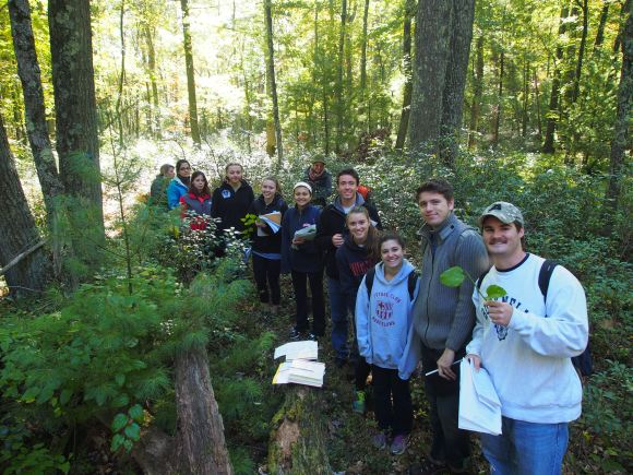 PHOTO: Martine's field botany class on a research trip in the woods.