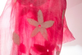 PHOTO: A gauzy, pink silk scarf with felted white 5-petal flowers.