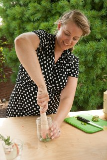 PHOTO: The Fountainhead Chicago mixologist Kasey Bersett muddles basil leaves in a Mason jar.