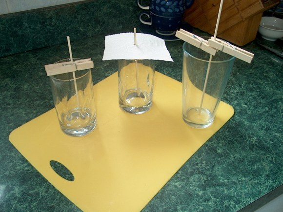 PHOTO: Glasses and skewers set up for making rock sugar candy.