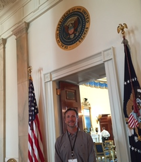 PHOTO: Jim O'Malley under the presidential seal at the door to the Blue Room in the White House.