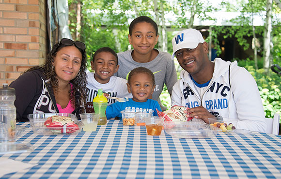 Military family eating lunch at the Garden's USO Military Appreciation Day.