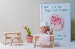 Like many characters, Mrs. Tiggy-Winkle is displayed with the storybook that made her famous.