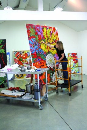 Gottlieb works on one of the Extinct Botanicals canvases in her studio.