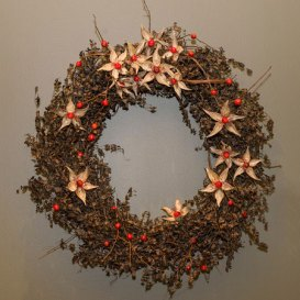 Star-shaped flowers are made from milkweed pods, with a crabapple at the center.