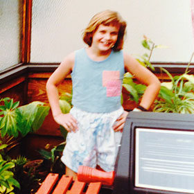 Heather in a greenhouse in California, age 7
