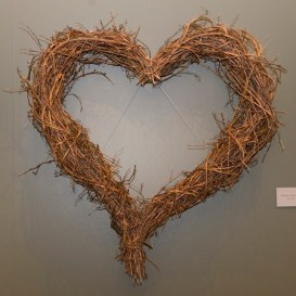 PHOTO: Large, heart-shaped wreath made from grape vines.