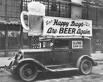 "PHOTO: a Post-Repeal Day truck sports a sign with the slogan, ""Happy Days are Beer Again!"""