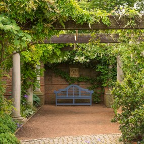 PHOTO: The blue bench in the niche at the English Walled Garden.