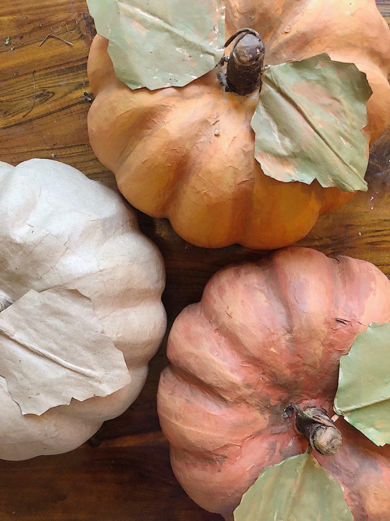 three painted pumpkins