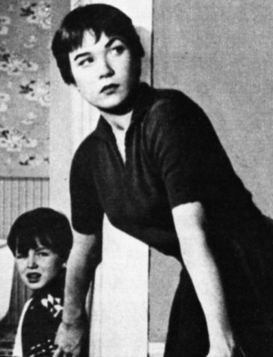 """No wonder Shirley looked worried in """"The Trouble with Harry"""" (here seen with the child who played her son - Jerry Mathers), for who had really killed the corpse they called Harry?"""