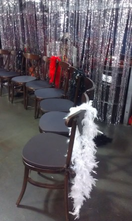 Feather boas decorate chairs