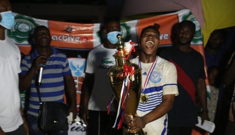Kingdom FC celebrating with their trophy