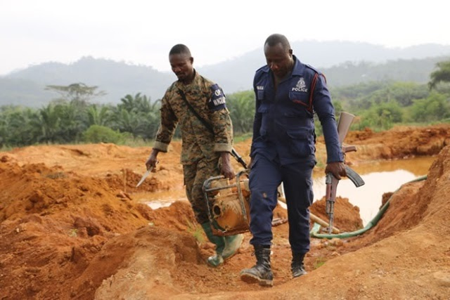 security officers retrieving items used by illegal miners