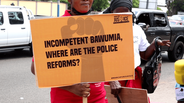 """A placard with the caption """"Incompetent Bawumia, Where are the Police Reforms?"""""""