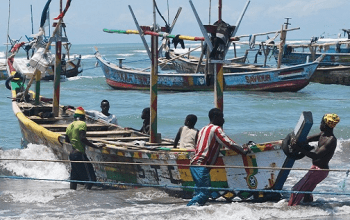 fishermen pulling their boats out of water