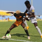 Ashanti Gold and Berekum Chelsea players struggle for the ball in their MTN FA Cup semi-final match at the Cape Coast Sports Stadium on August 1, 2021