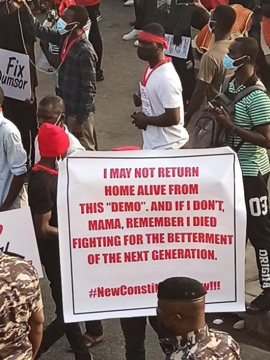 FixTheCountry display a placard telling the mother if he doesn't return alive, he died fighting for a better life for the next generation