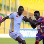 Hearts of Oak and Wydad AC players rush for the ball