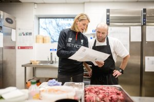 Mona Nemmer, Liverpool's new head of nutrition, discussing a menu with the chef Leigh Lawson at Liverpool's training base. Credit Rob Stothard for The New York Times