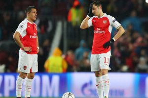 Alexis Sanchez (left) and Mesut Ozil are both yet to commit their futures to Arsenal