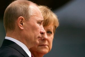 Vladimir Putin and Angela Merkel in 2012. Credit Thomas Peter/Reuters