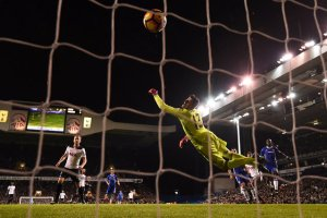 Dele Alli's first goal beat Chelsea goalkeeper Thibaut Courtois late in the first half on Wednesday. Credit Dylan Martinez/Reuters