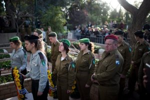 Israeli soldiers at the funeral of Lt. Yael Yekutiel in Tel Aviv on Monday. Lieutenant Yekutiel was one of four Israeli soldiers killed in a truck attack in Jerusalem on Sunday. Credit Abir Sultan/European Pressphoto Agency