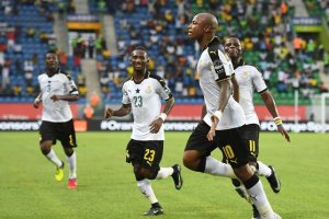 André Ayew leads the Ghana celebrations after his winner put Avram Grant's side in pole position to qualify from Africa Cup of Nations Group D. Photograph: Justin Tallis/AFP/Getty Images