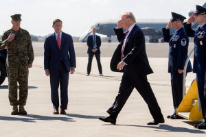 President Trump at MacDill Air Force Base in Tampa, Fla., on Monday. Second from right is Michael T. Flynn, national security adviser. Credit Stephen Crowley/The New York Times