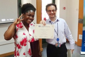 Mr Jon Benjamin (right) presenting a certificate to Adelaide Arthur (left), one of the scholars.PICTURE : OWUSU INNOCENT.