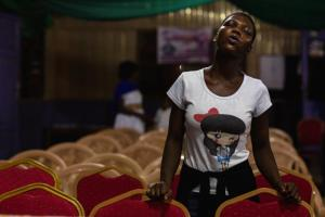 A member of the Victory Bible Church, Peniel Sanctuary, prays to usher in the New Year in Accra, Ghana December 31, 2016. REUTERS/ Francis Kokoroko