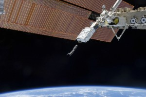 The Small Satellite Orbital Deployer (SSOD), in the grasp of the Kibo laboratory robotic arm, is photographed by an Expedition 38 crew member on the International Space Station as it deploys a set of CubeSats. Credit: Reuters