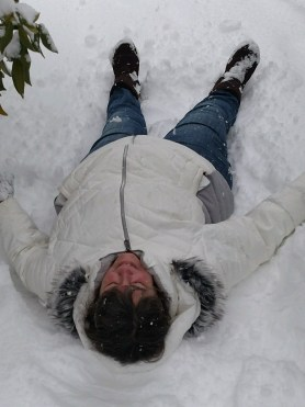 woman laying in snow